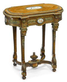 A Napoleon III porcelain and gilt bronze mounted walnut jardinière table  third quarter 19th century