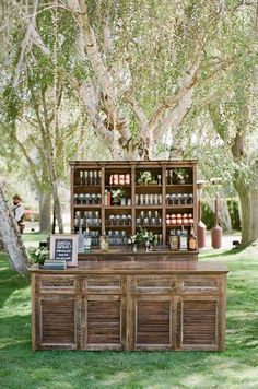 Lush garden wedding vintage bar Bring the indoors out with residential inspired furnishings. A stately bar will remind guests of the way people entertained in days gone by, as well as create a can't-miss focal point for cocktail hour. Copper Wedding, Rustic Wedding, Wedding Ideas, Bar For Wedding, Drink Station Wedding, Wedding Details, Unique Wedding Food, Farm Table Wedding, Wedding Decor