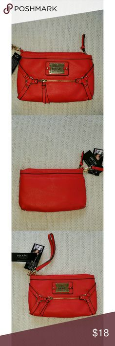 *HP*GREAT GIFT! NICOLE MILLER RED WRISTLET NICOLE MILLER RED OVER SIZED WRISTLET it is beautifully detailed with gold tone hardware. It has an inside pouch for your cell phone and several slots for cards. Outside front has a zip pouch and on the back has an additional open pouch! Nicole by Nicole Miller Accessories