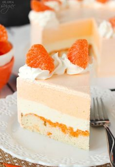 This Orange Creamsicle Ice Cream Cake is light, fruity and just like eating an orange creamsicle in ice cream cake! I'm so excited to share it with you!