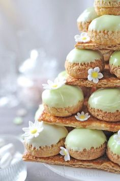 "French. ""Je veux une montagne de choux..."" . Cake made of layered profiteroles. A craquelin is put on top of the pate a choux to create a crackled crust texture."
