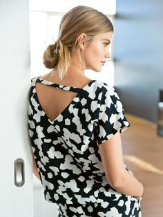 This sexy short sleeve blouse features an open triangle back but don't worry, it won't slip off your shoulders thanks to a bar strap at the shoulders.