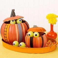Peeking Pumpkins | 30 Easy Halloween Pumpkin Ideas (No Carving Required!) | AllYou.com Mobile