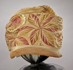 1920s silk and straw embroidered cloche hat.