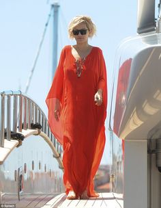 Lady in red: Singer Rita Ora found was spotted lounging on Roberto Cavalli¿s yacht while in Cannes on Saturday