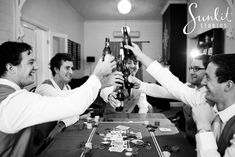 Groom's Getting Ready Photo - playing poker with Groomsmen! Photography by Sunlit Studios