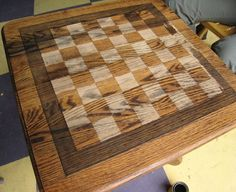 I am going to add this to my summer projects....atop my son bed side table and instead of stain I am going to paint it a beautiful shade of dark blue..now what color to paint the squares???...he loves to play chess