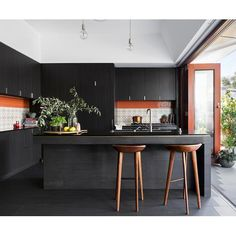 Check out this Perth kitchen renovation, which combines retro splashback tiles with a moody colour palette.