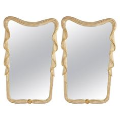 Pair of Carved Italian Silver Gilt Mirrors | From a unique collection of antique and modern wall mirrors at https://www.1stdibs.com/furniture/mirrors/wall-mirrors/