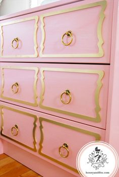 Refinished pink dresser with gold hardware and gold embellishments on the front.