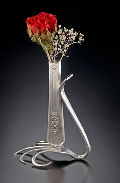 re-wrought silverware - bud vase (this could also double as a chic take-home gift)