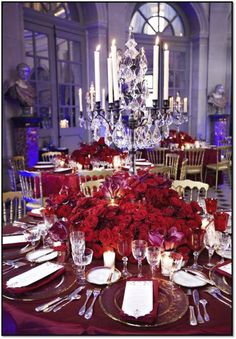 Festive floral table decoration on rooftop in Paris with Red Naomi roses by Porta Nova. Floral design by Jeff Leatham