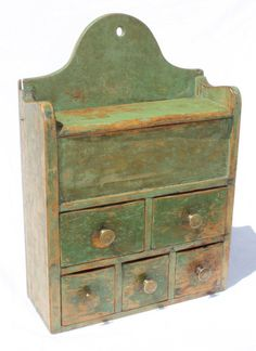 "Sold For $ 1,500         	   	        	   	           	      	                  ca 1720-1740 CT QA period wall hanging 5 drawer spice cabinet w lift compartment in yellow pine & orig green paint from the Dunphey Collection - 17"" tall x 11 1/2"" wide"