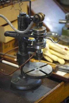 Very small drill press with finger pressure drilling capability