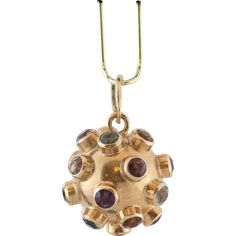This is a wonderful 18 karat gold sputnik orb, encrusted with a plethora of genuine gemstones. The gemstones are approximately 2.5-3mm in diameter..