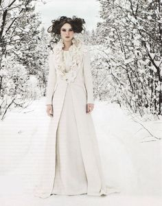 Bouclé wool and satin bodice dress, bouclé wool coat with floral collar by Bruce Oldfield. Image © Carl Bengtsson