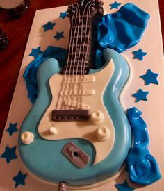Guitar Cake Used the Wilton guitar pan, cut out the areas to make it look more like an electric guitar. Music Themed Cakes, Theme Cakes, 5th Birthday Party Ideas, 50 Birthday, Birthday Cakes, Chocolate Covered Coffee Beans, Satin Ice Fondant, Movie Cakes, 40th Cake