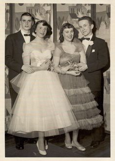 The epitome of 1950's prom, tea length dreses with a strapless neckline and layers of tulle.Found here.