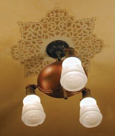 Stencil on a ceiling around pretty light fixture | European Lace Ceiling Medallion | http://www.royaldesignstudio.com/