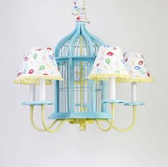 Birdcage chandelier! I have a birdcage  and the light fixture. I am so going to make this!!