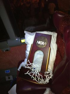 Jayhawks Final Four trophy gets comfy on the bus ride back to Lawrence