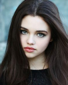 India Eisley. Girl is so dang pretty and looks like the Ana Steele in my head.-- She could play her! Never thought about it... hmmm. She plays on sweet life of the American teenager!