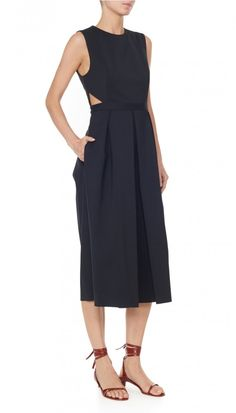 Cut in a sturdy yet lightweight fabrication, this jumpsuit silhouette flatters multiple body types with subtle cutouts at the waist. As the quintessential day-to-evening piece, it can be worn season after season and act as a building block to the wardrobe rotation. Pants unlined. 48% Cotton, 45% Polyamide, 7% Elastane. Professional Dry Clean Only.Style Number: S218AG2050Available in: Black, Ivory