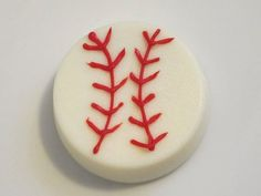Dip Oreo in white chocolate..let dry…use RED  frosting pen, tube frosting or homemade frosting to draw on baseball stitches.