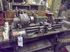 """ATLAS TABLE TOP LATHE, MODEL No. QC-42, S/N: 000765, 11"""" SWING, 22"""" CENTERS, 3-JAW CHUCK, STEADY REST, DOUBLE CROSS SLIDE, 110 VOLT WITH BOX OF ACCESSORIES INCLUDED Bidding Open Now and Begins to Close on May 21st Bidding Starts to Close at 1:00 PM/Eastern on the final day of bidding http://bid.acceleratedbuysell.com/cgi-bin/mnlist.cgi?perillo64%2F163"""