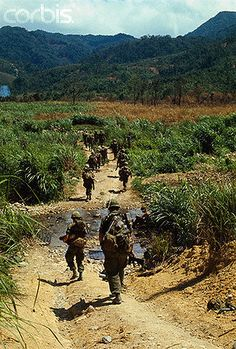 02 May 1968, A Shau Valley, South Vietnam --- A Communist built road serves as a footpath for members of the 1st Cavalry Division during Operation Delaware in the A Shau Valley. The road was built with metal strips, normally used by allied forces for constructing landing strips. It was disclosed April 28th that the cavalrymen had invaded the valley and fought a costly battle to establish a foothold in the Communist enclave. --- Image by © Bettmann/CORBIS