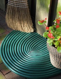 Got an old garden hose that doesn't work? Why not turn it into a mud room rug or door mat?