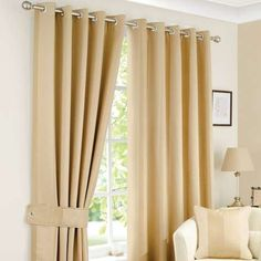 These antique gold curtains feature a subtle striped design and have an eyelet header, making them easy to hang....