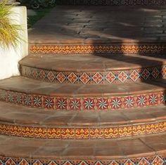 Spanish Pavers with Decorative Spanish Tile Risers Create Charm