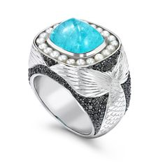 Theo Fennell Black Diamond & Seed Pearl ring in white gold, set with a 7.26ct Paraiba tourmaline (£19,500).