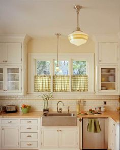 """Two Arts & Crafts Kitchens: Bungalow Basic & Adirondack Spirit Stainless steel is frankly modern yet timeless in a practical room that evokes the """"sanitary kitchens"""" of the bungalow era: white tile and washable paint. 1920s Kitchen, Home Kitchens, Kitchen Remodel, Kitchen Design, Bungalow Kitchen, Modern Kitchen, Kitchen Interior, Kitchen Style, Craftsman Kitchen"""