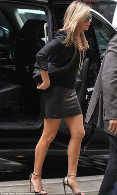 Sexy: Jennifer went for a leather mini skirt and chic blazer for her first appearance at a press conference