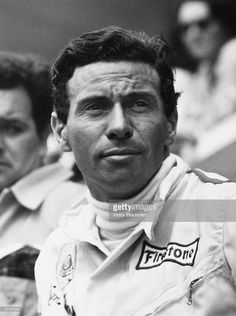 Racing driver Jim Clark (1936 - 1968). He has a logo for Firestone tyres on his racing overalls.