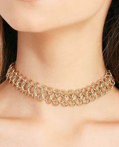 "<p>A metal tattoo choker statement necklace featuring a chunky chain body.</p>  <ul> 	<li>16.5"" Length</li> 	<li>Lobster Clasp Closure</li> 	<li>Metal</li> 	<li>Imported</li> </ul>"