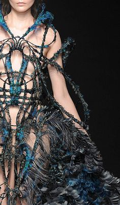 Yiqing Yin....I could see this as Pandora's dress when she is given as a gift to the world, exotic and dark