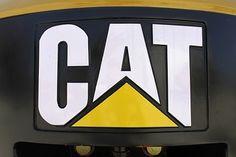caterpillar ag equiptment | Cat Tractor hauling ahead.