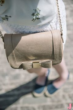 A little neutral bag is perfect for when you're traveling and want to be hands free.