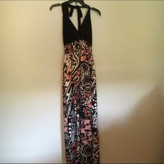 Dress Maxi dress black with multi colored patterned skirt.  Polyester stretch pulls over head without zipper.  Halter top ties at neck .  Open upper back area. Dresses Maxi