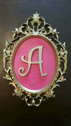 A's party - Used gold spray paint on silver mirror frame, spray-painted the back of the mirror pink and reassembled. Spray painted the wood letter A with gold glitter spray paint.