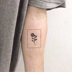 Black rose tattoo on the inner forearm.