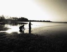 Sepia photo of net fisherman by DeGroom