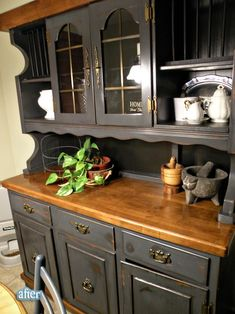 Black hutch = neat leaving top board brown.  Think I'm totally going to do this with our hutch.  I would change the hardware on this one though... take off the colonial & put on farmer pulls. by kelseyinfo
