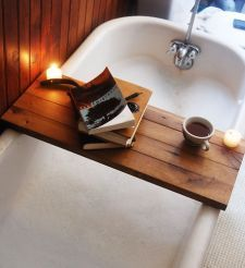 dream tub, obv with champagne holder // my mom has this, but with champagne glass holder. crucial.