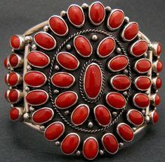 Cuff | Albert Jake. (Ramah Navajo, New Mexico.).  Sterling silver with gem grade coral