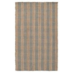 Lend a touch of natural appeal to your entryway or den with this handsome jute rug, showcasing a woven stripe design.  Product: ...