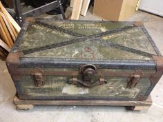 """Old military trunk and reclaimed 2x4s with metal caster wheels. DIY, done! :-) My """"new"""" coffee table!"""